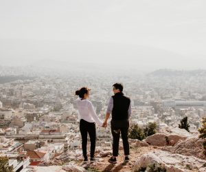 Man and woman overlooking Athens